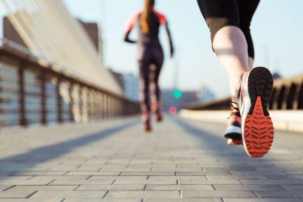 close-up-woman-running-on sidewalk