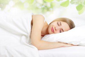 woman asleep on pillow